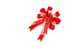 Красная тесемка при смычок изолированный на белой предпосылке Стоковые Фото