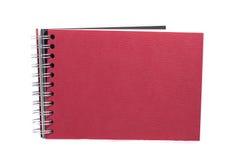 Красная тетрадь изолированная на белизне Стоковое Изображение