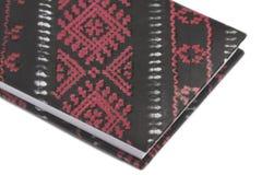 Красная тетрадь на белой предпосылке Стоковое Изображение
