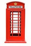 Красная телефонная будка изолированная на белой предпосылке Стоковое Изображение RF