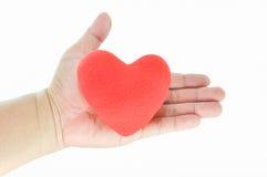Красная форма сердца в руке Стоковые Изображения