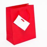 Красная хозяйственная сумка стоковое фото