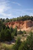 Красная шахта песк-утеса стоковое фото