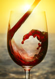 Красное вино и заход солнца Стоковое Изображение RF