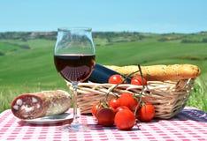 Красное вино, хлеб и томаты Стоковая Фотография