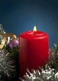 Красное горение свечки рождества Стоковая Фотография