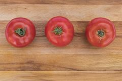 3 красное, зрелые томаты Стоковое Изображение