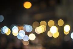 Красное и оранжевое bokeh праздника абстрактное рождество предпосылки Стоковые Фотографии RF