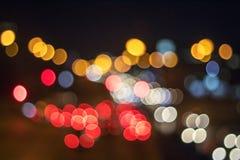 Красное и оранжевое bokeh праздника абстрактное рождество предпосылки Стоковое Фото