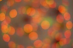 Красное и оранжевое bokeh праздника Стоковые Изображения RF