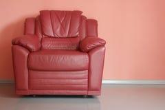 Красное кресло в красной комнате Стоковое фото RF