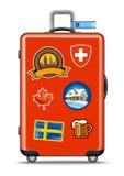красное перемещение чемодана стикеров Стоковая Фотография