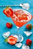 Красное питье на голубой предпосылке Стоковые Фотографии RF