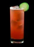Красное питье при кусок огурца изолированный на черноте Стоковая Фотография RF