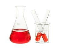 Красное решение в склянке и пробирке Стоковое Изображение