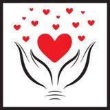 Красное сердце в hands1 Стоковое Фото