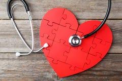 Красное сердце головоломки Стоковые Изображения