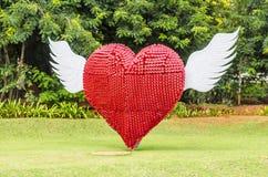 Красное сердце летая Стоковые Изображения