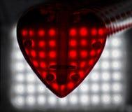 Красное сердце над запачканной предпосылкой влияния bokeh Стоковая Фотография RF