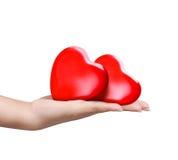 Красное сердце на руке женщины Стоковая Фотография