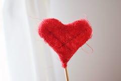 Красное сердце на ручке сделанной от потока Стоковое Изображение RF