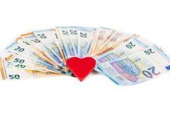 Красное сердце с евро евро замечает отражение love money стоковое фото rf