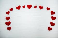 Красное сердце сделанное из войлока различного размера Стоковая Фотография RF