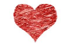 Красное сердце сделанное из обжатой изолированной переклейки на белой предпосылке Стоковая Фотография
