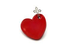 Красное сердце с крестом Стоковая Фотография