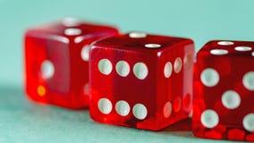 Красное стекло dices представленный Стоковое Изображение