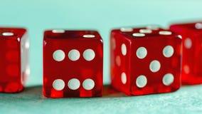 Красное стекло dices представленный Стоковые Изображения