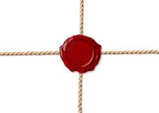 Красное уплотнение воска над пересеченными веревочками иллюстрация штока