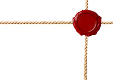 Красное уплотнение воска при пересеченные изолированные веревочки стоковое изображение