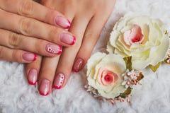 Красное французское искусство ногтя с цветком Стоковая Фотография RF