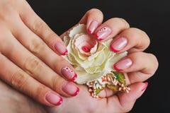 Красное французское искусство ногтя с цветком Стоковое фото RF