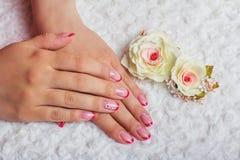 Красное французское искусство ногтя с цветком Стоковая Фотография