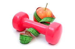 Красное яблоко и гантель Стоковая Фотография