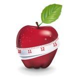 Красное яблоко при измеряя изолированная лента Иллюстрация штока