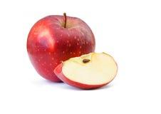 Красное яблоко с частью на белой предпосылке Стоковые Фото