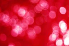 Красное bokeh праздника абстрактное рождество предпосылки Стоковое Изображение