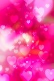 Красное bokeh сердец как предпосылка стоковое изображение
