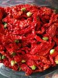 Красное Chilis на черной предпосылке Стоковое фото RF