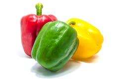 Красное peper зеленого и желтого колокола на белой предпосылке Стоковая Фотография