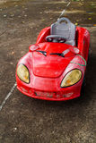 Красное Toycar на дороге Стоковые Фотографии RF