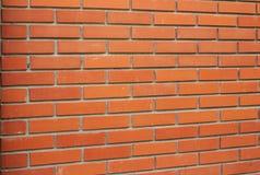 Красной, коричневой предпосылка текстурированная кирпичной стеной стоковое фото