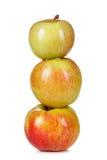 3 красно-желтых яблока на белой предпосылке Стоковая Фотография