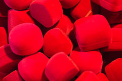 Красные аксессуары кладут обои и предпосылки в коробку текстуры деталей роскоши Стоковое Изображение