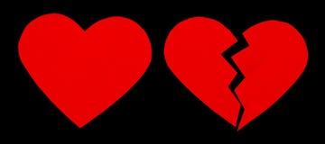 Красные большое горе/разбитый сердце закройте вверх бумажного разбитого сердца Стоковые Изображения RF