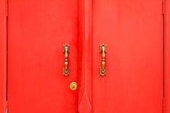 Красные двери стоковые фото