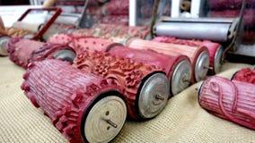 Красные винтажные ролики краски стоковое фото rf